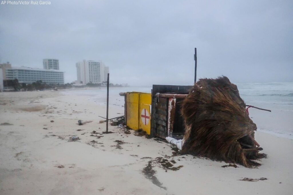 A lifeguard tower lays on its side after Hurricane Delta toppled it over in Canc...