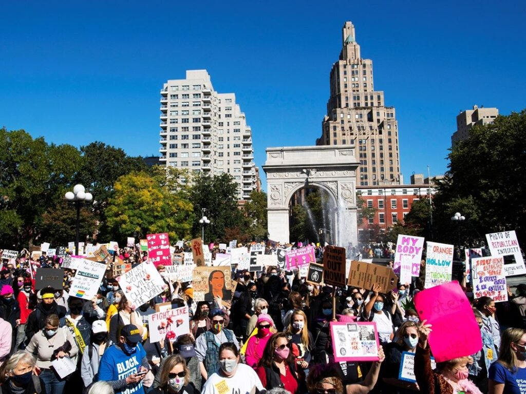 Activists take part in the 2020 Women's March in New York City — one of the hund...