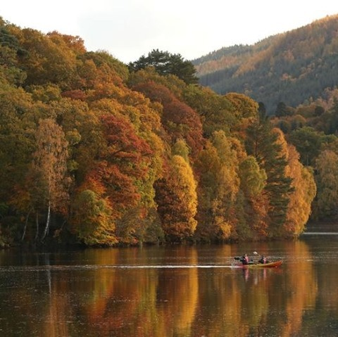People kayak on a reservoir surrounded by autumn leaves in Pitlochry, Scotland.⁠...