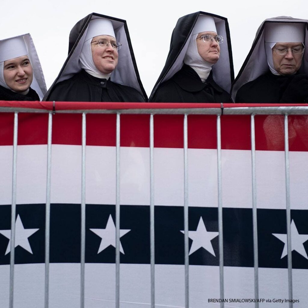 """Little Sisters of the Poor wait for President Donald Trump to speak during a """"Ma..."""