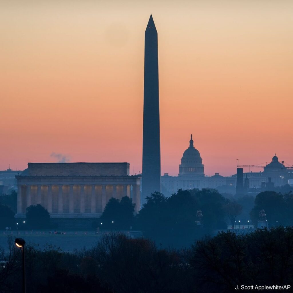 The Lincoln Memorial, Washington Monument and the U.S. Capitol are seen at dawn ...