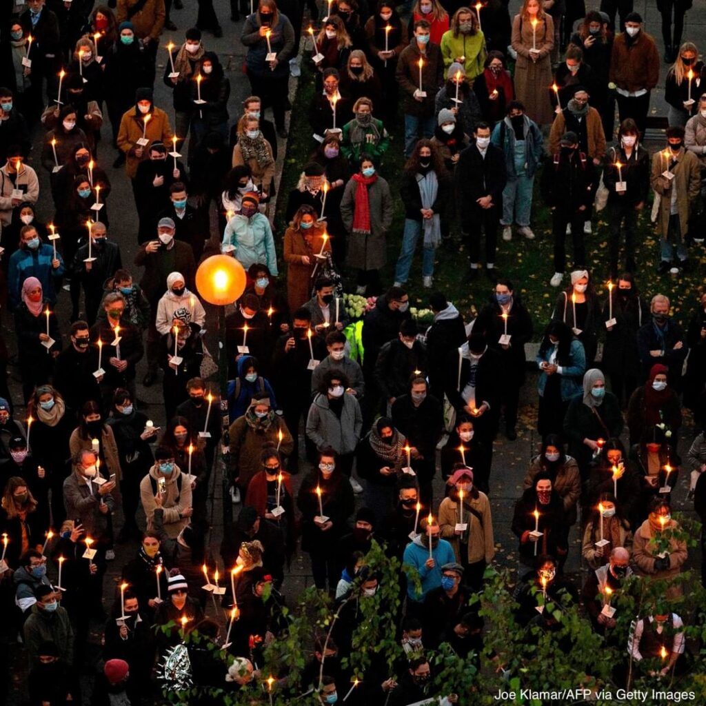 A candlelight vigil took place to remember the victims of the attack in Vienna, ...
