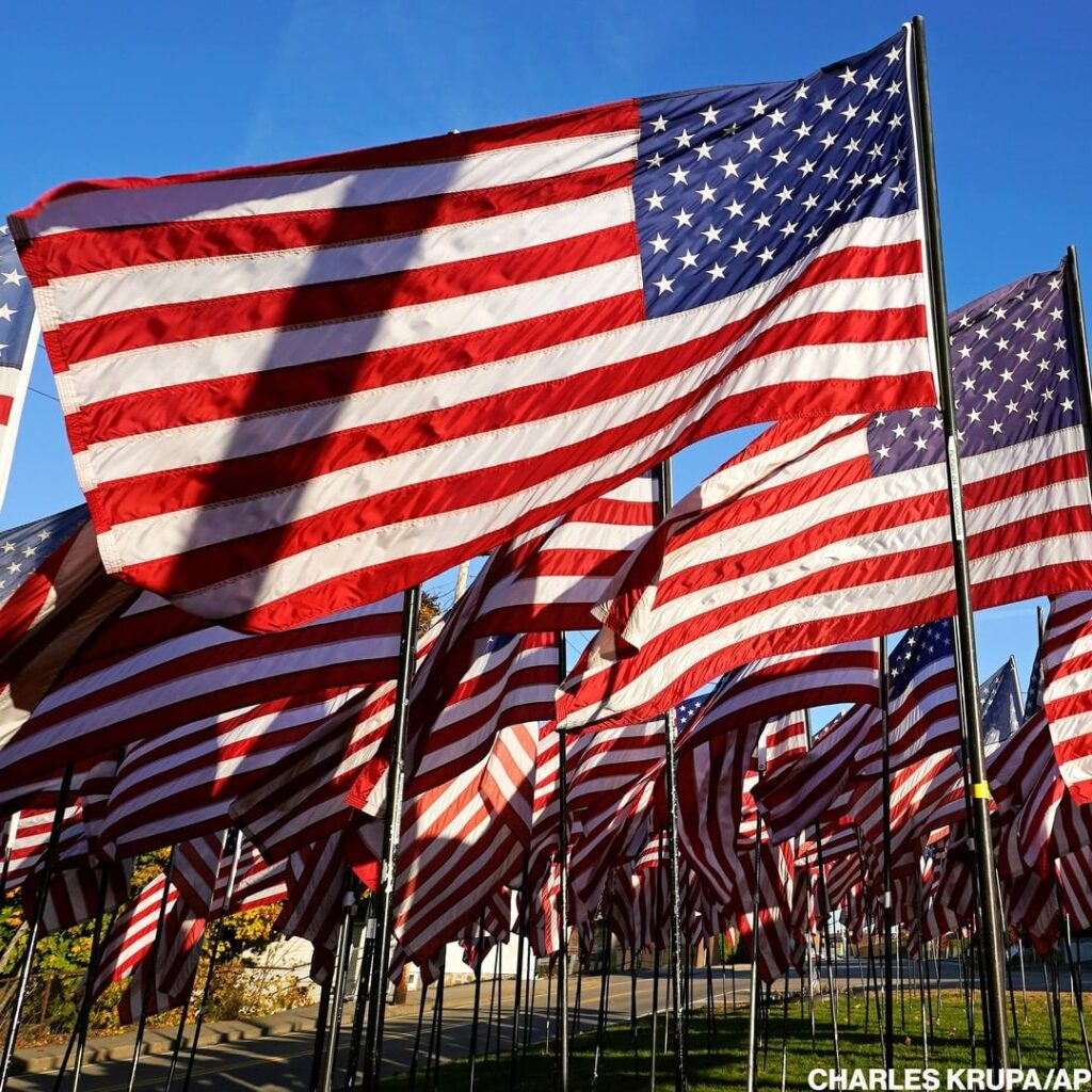 A field of American flags planted in Quincy, Mass., honors those who served in o...