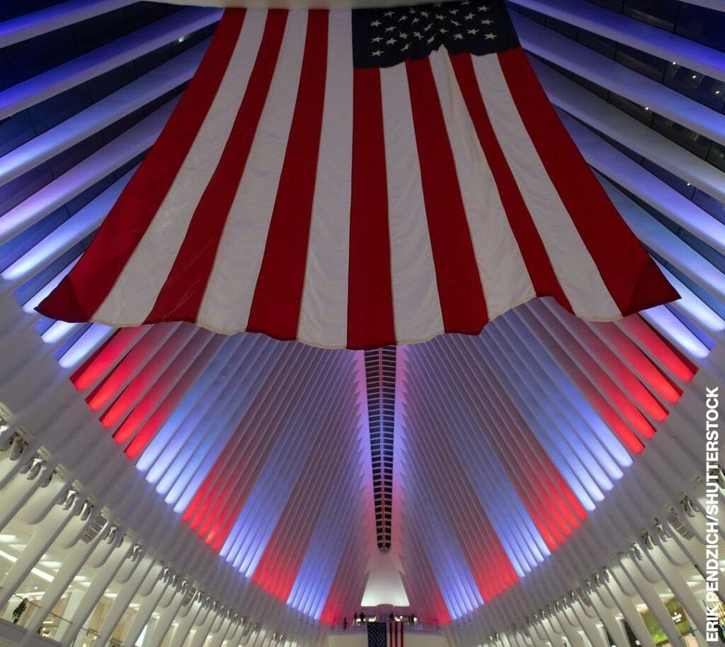 The Oculus of the World Trade Center in New York City lit up in red, white and b...