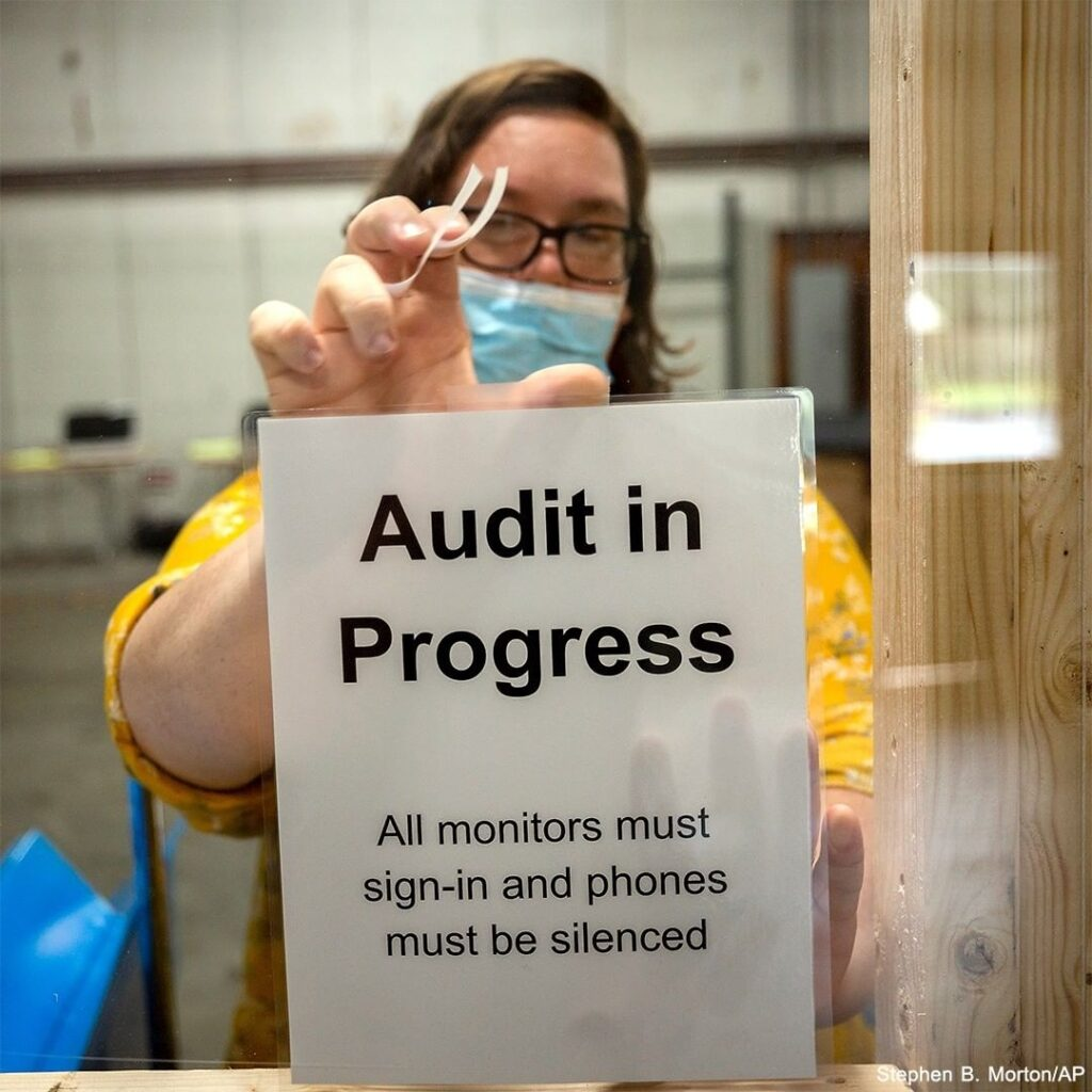 AUDIT IN PROGRESS: A Chatham County election official posts a sign before beginn...
