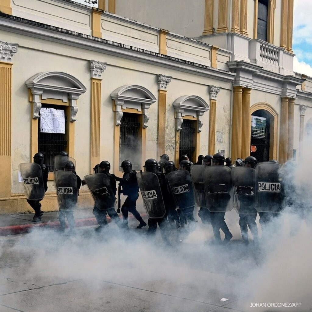 Riot policemen take position during a protest demanding the resignation of Presi...