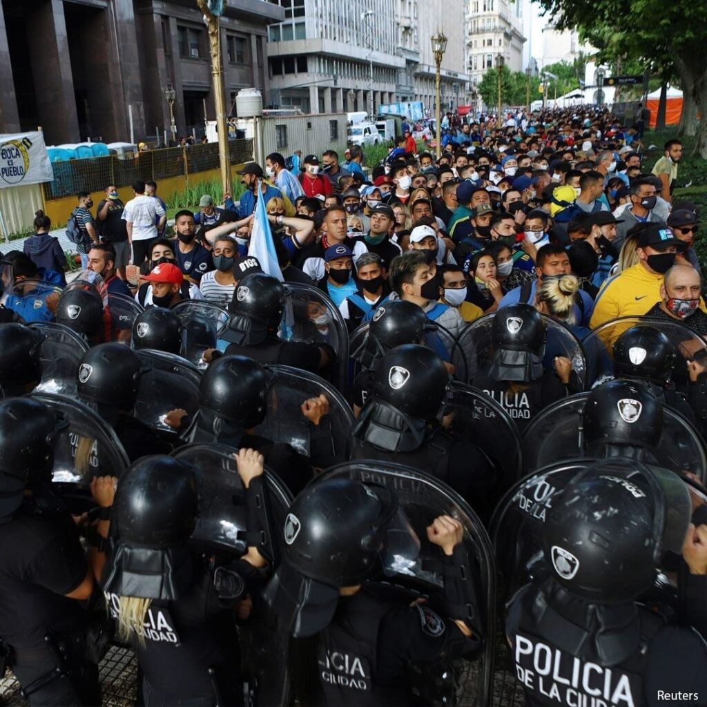 Thousands of fans line up for the wake of soccer legend Diego Maradona at the pr...