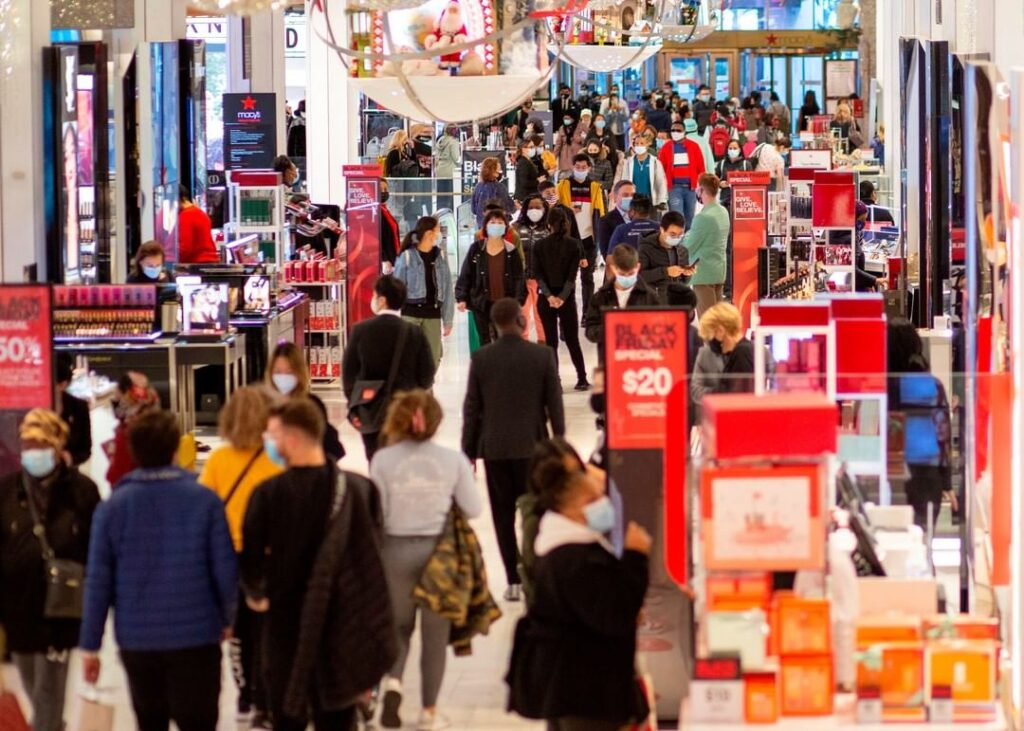 Customers shop at Macys department store in New York on Black Friday. Despite co...