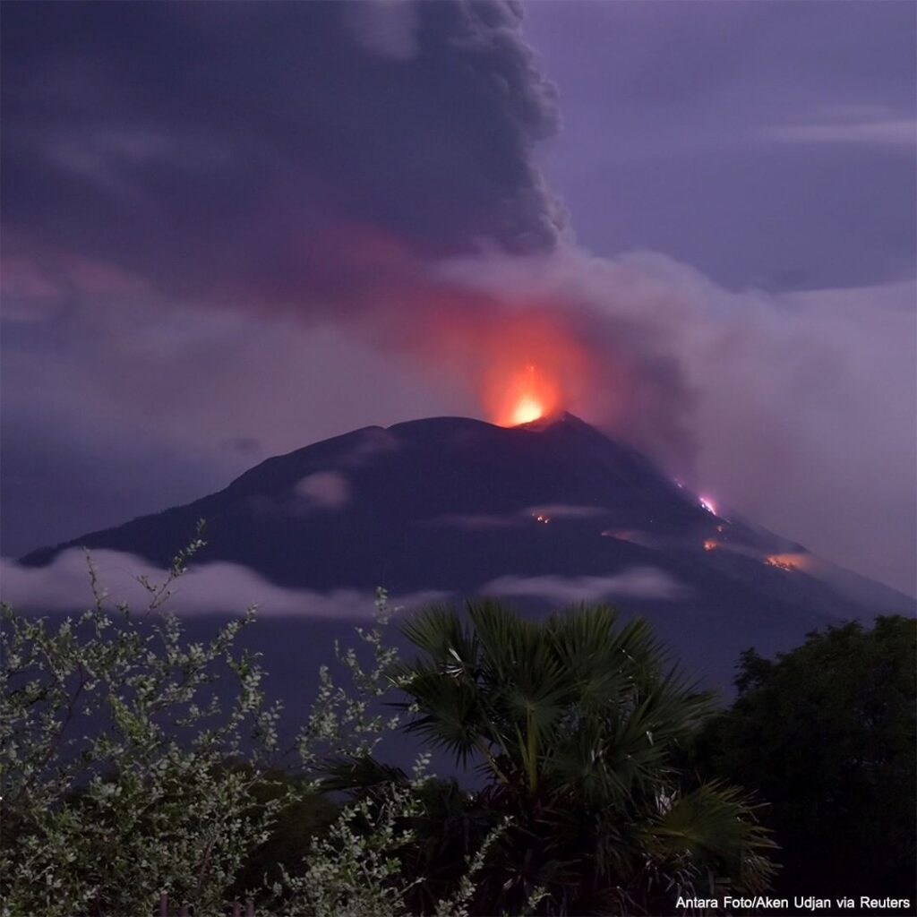 Indonesia's Mount lli Lewotolok erupted Sunday morning, sending a column of smok...